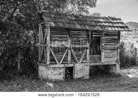 black and white photography, white and black photo, black and white image, Corn Crib in black and white color, black and white, white and black, old house in black and white, wooden house in black and white, antique building in black and white,