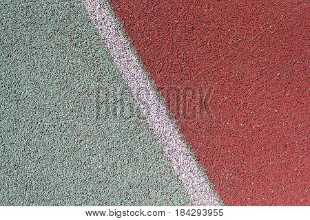 Colored rubber coating of the stadium's treadmill. Backgrounds and textures