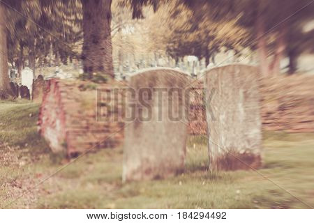 Blurred Cemetery Tombstones