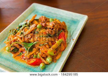 Stir-fried frog and basil on wooden Amazing Thailand spicy food
