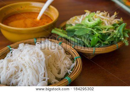 coconut milk call Kha Nom Jeen Kaeng Kai in Thai served on Thai Pattern dish.