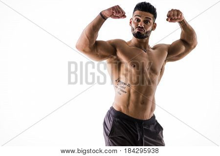 Handsome bodybuilder doing classic double biceps pose with funny, silly expression, looking at camera, isolated on white background