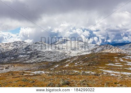 Snow Covered Mountains Under Beautiful Clouds In Australia