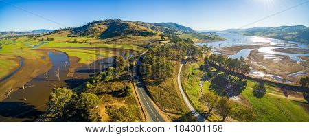Aerial Panorama Landscape Of Murray Valley Highway And Bridge Over Lake Hume On Bright Sunny Day. Vi