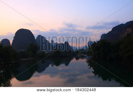 Karst mountain and Yulong river landscape in Yangshou China