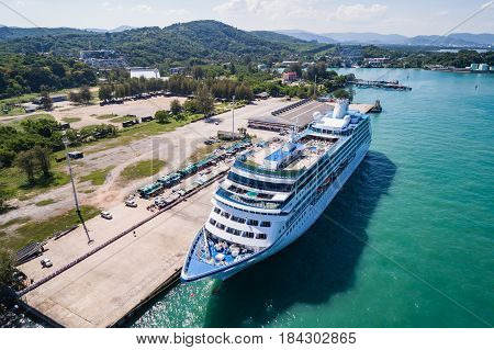 PHUKET THAILAND - APRIL 16 : Big cruise ship 'Insignia' standing at the harbour on April 16 2017 in Phuket Thailand. Aerial view from flying drone