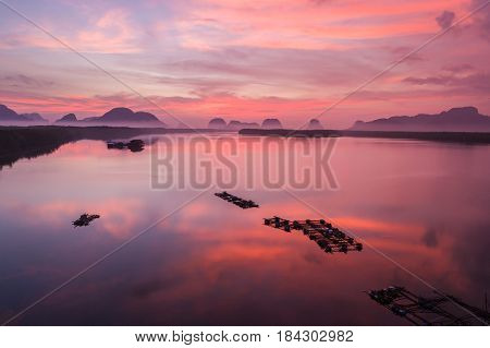 Silhouette rock mountain in sunrise time at Phang-Nga bay southern of Thailand. Aerial view from flying drone