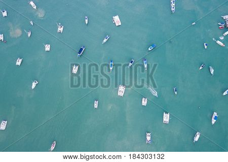 Top view speed boat parked in the sea at Chalong bay Phuket province Thailand. Aerial view from flying drone