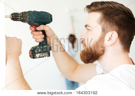 Portrait of bearded man making repair in new home isolated
