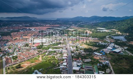 PHUKET THAILAND - APRIL 26 : Top view of building and house of Phuket province in town area and view of dark clouds before raining in Phuket on April 26 2017. Aerial view from flying drone