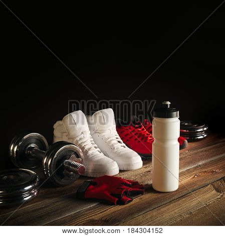 Fitness Equipment And Supplements On Wooden Floor In Gym Fitness Background With Pair Of Sneakers Wa