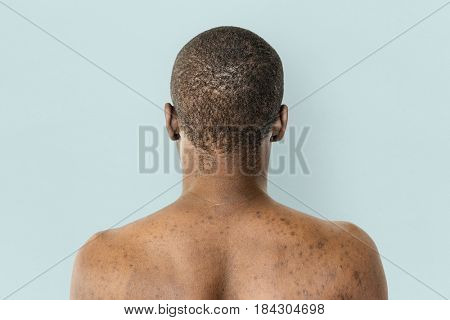 Man shirtless rear view studio portrait