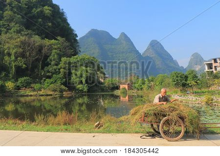 YANGSHOU CHINA - NOVEMBER 18, 2016: Unidentified man works in a country village.