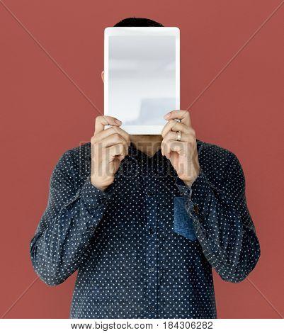 Man holding blank digital tablet cover face studio portrait