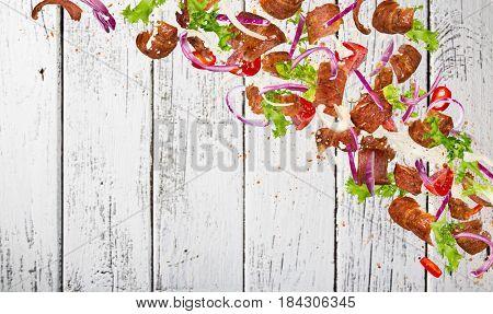 Kebab ingredients flying, close-up. Freeze motion.
