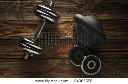 Top view of black iron kettlebell dumbbell on wooden floor Sport background with copyspace Weight lifting exercise concept.