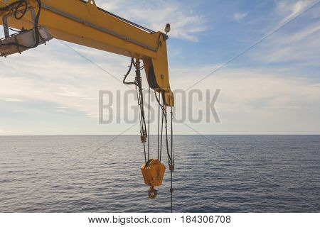 Boom crane wait for lifting in the sea offshore