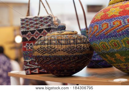 jug storage and basket made of clay decorated with colorful string hand crafted from traditional Indonesia culture Asia