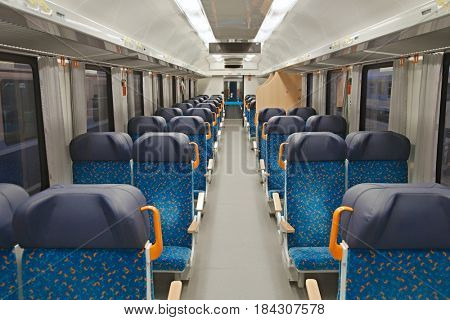 Interior of a passenger train with empty seats