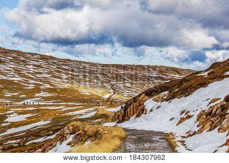 People Walking On Mount Kosciuszko Summit Walk. Snowy Mountains, Australia