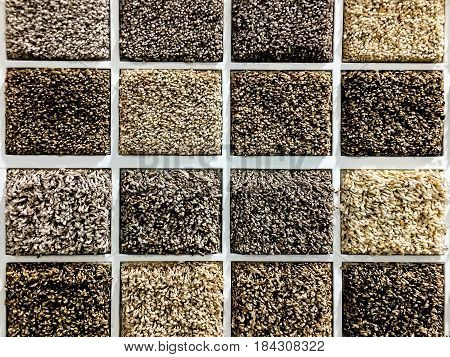 Shop carpets. Picker carpet. Carpet samples in the store. carpet made of looped and sheared fibers, carpet color samples