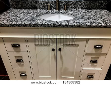 white bathroom cabinet, bathroom cabinets, vanity cabinets in the bathroom, white bath cabinets, cabinet with granite countertop, vanity bathroom cabinet with white porcelain sink, contemporary style of bathroom cabinets, white bath cabinet with chrome ha