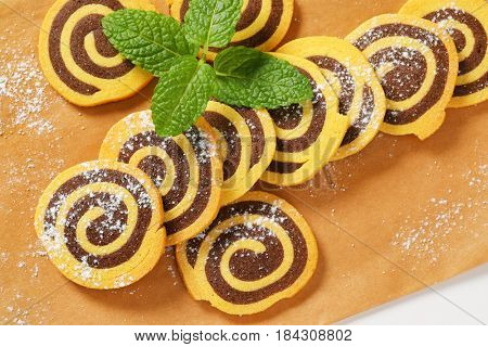 sweet chocolate rolls on baking paper