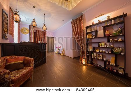 Empty beautiful reception room in thai day spa with many asian decoration