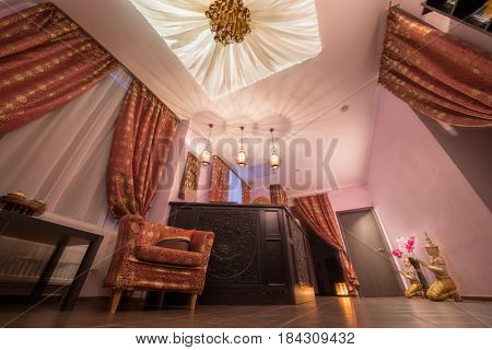 Wooden reception in thai day spa with asian decoration and canopy