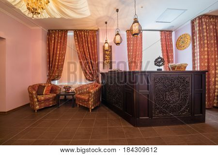Empty room with wooden reception in thai day spa with many asian decoration