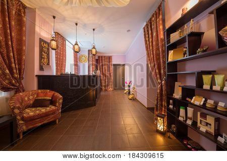 Empty reception room in thai day spa with many asian decoration