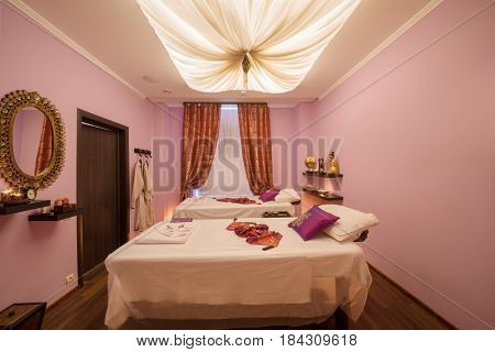 Empty cozy room with two beds for thai massage and asian decoration