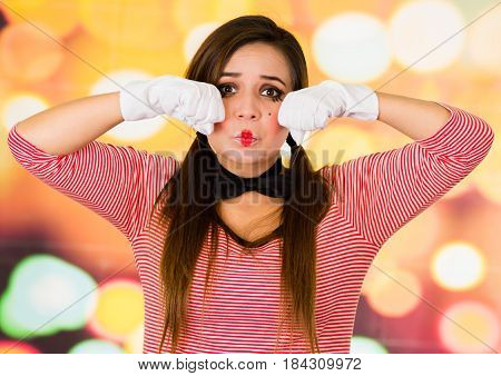 Closeup portrait of female clown mime crying expressing sadness