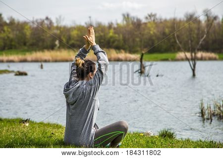 Girl In Sportswear Doing Yoga In Nature