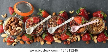 Dessert with muesli and strawberries on a gray background