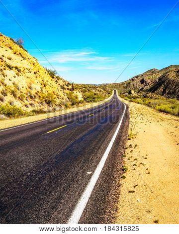 The Bartlett Dam Road as it winds through the semi desert landscape of Tonto National Forest in Arizona, United States