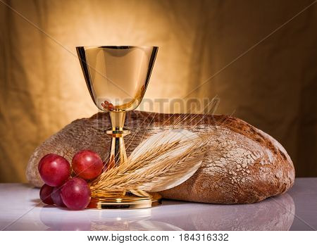 holy communion of golden chalice on top of the table