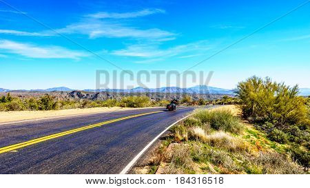 The quiet curved Bartlett Dam Road between the town of Cave Creek and Lake Bartlett in Tonto National Forest in Maricopa County near Phoenix Arizona in the USA