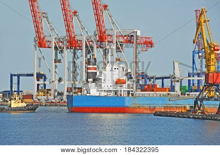Tugboat Assisting Bulk Cargo Ship