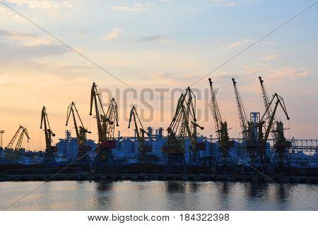 Port Cargo Crane At Sunset