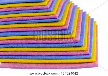 pile of color napkins for kitchen on a white background