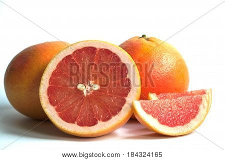 Closeup of red grapefruits on a white background