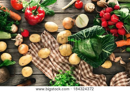 Set of different vegetables for cooking healthy food on a wooden table top view