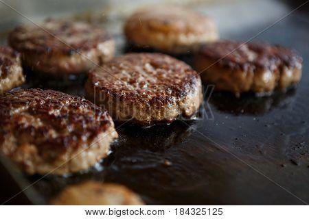 Cooking Hamburger In Fast Food Restaurant