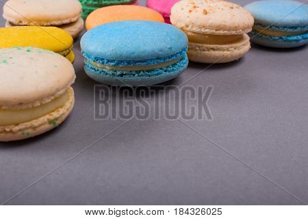Cake macaron or macaroon colorful cookies. On a gray background. Empty space for text