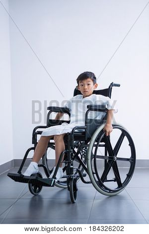Disabled boy patient on wheelchair at hospital