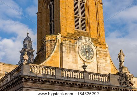 All Saints church clock in the centre of Northampton England.