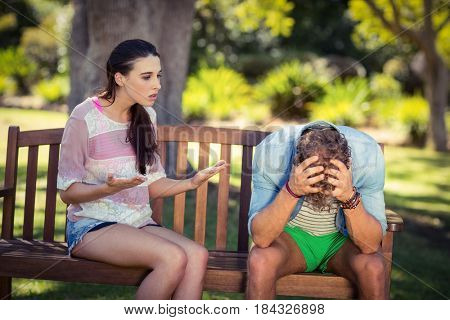 Unhappy couple arguing in park