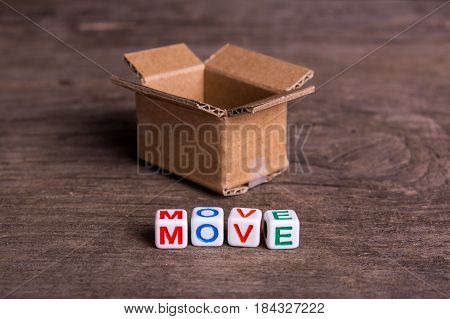 Moving to another office or house. Word move on an old wooden background