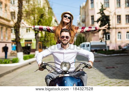 Couple in love riding a motorbike Handsome guy and young sexy woman travel . Young riders enjoying themselves on trip. Adventure and vacations concept.